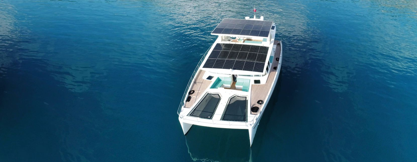 With three levels and four main cabins, this solar yacht sleeps up to 12 people, including a crew of four.