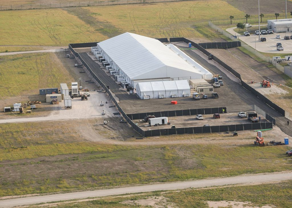 A temporary holding facility near the Donna-Rio Bravo International Bridge is seen from the air on Wednesday, May 1, 2019 in Donna, Texas. Officials say the soft-sided tent facility will primarily be used as a temporary site for processing and care of asylum seekers crossing the border and will increase the Border Patrol's capacity to process migrant families while they await transfer to U.S. Immigration and Customs Enforcement or to the Department of Health and Human Services. (Ryan Michalesko/The Dallas Morning News)