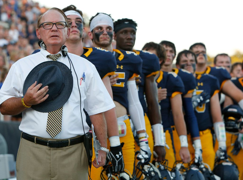 Highland Park head coach Randy Allen stands with his Scots players during the playing of the national anthem prior to the opening kickoff of their season against Rockwall. The two teams played their non-district season opening football game at Highlander Stadium in Highland Park on August 31, 2018. (Steve Hamm/ Special Contributor)