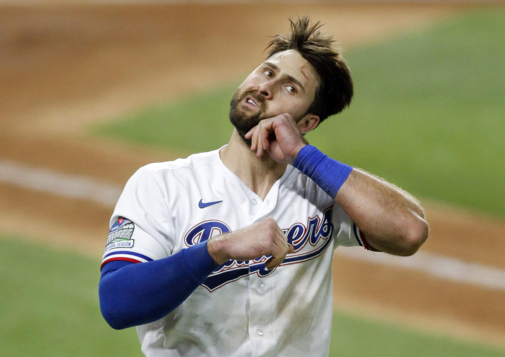 Texas Rangers batter Joey Gallo (13) stretches  after striking out to end the seventh inning at Globe Life Field in Arlington, Texas, Tuesday, September 8, 2020. (Tom Fox/The Dallas Morning News)