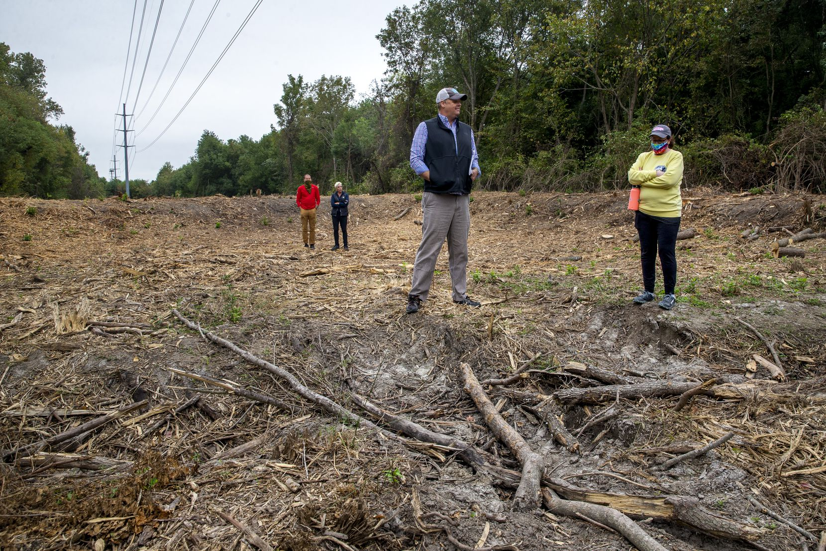 """Master naturalist Ben Sandifer (center) and City Council member Paula Blackmon (right) examine Oncor's clear-cutting, which Sandifer labeled """"a local extinction event."""""""