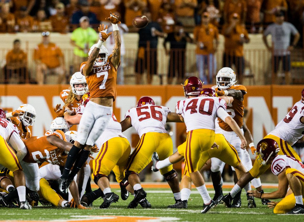 Texas Longhorns defensive back Caden Sterns (7) blocks a field goal attempt by USC Trojans place kicker Chase McGrath (40) during the third quarter of an NCAA football game between the Texas Longhorns and the USC Trojans on Saturday, September 15, 2018 at Darrell K Royal Memorial Stadium in Austin, Texas. Texas ran it back for a touchdown. (Ashley Landis/The Dallas Morning News)