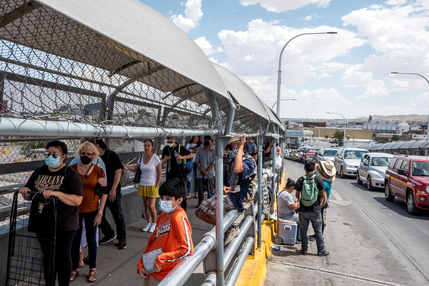 People wait in line to cross the border to El Paso, Texas through the Paso Del Norte Port of Entry in Ciudad Juarez, Chihuahua, Mexico, on Friday, June 26, 2020.