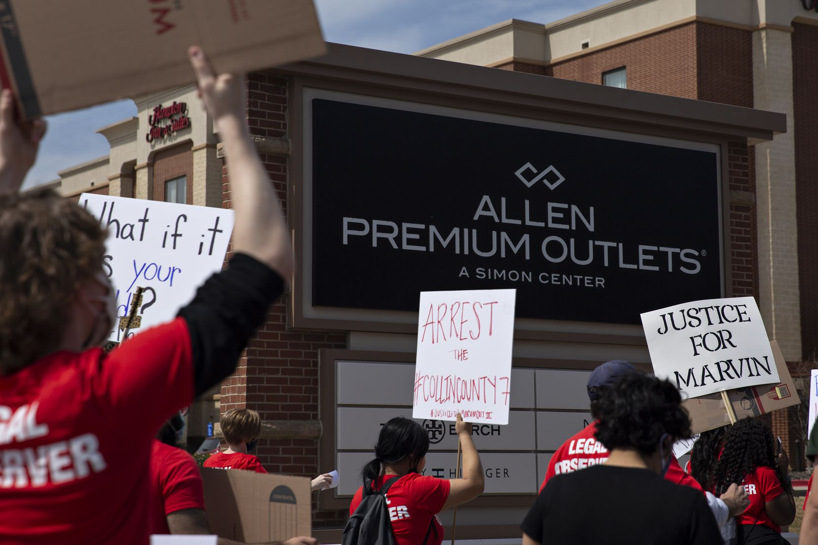People march to the Allen Outlets on Sunday, March 21, 2021 demanding justice for Marvin Scott III, who died a week prior while in custody at the Collin County Jail on March 14, 2021. Marvin Scott III was arrested at the Allen Outlets for possession of less than two ounces of marijuana.  (Shelby Tauber/Special Contributor)