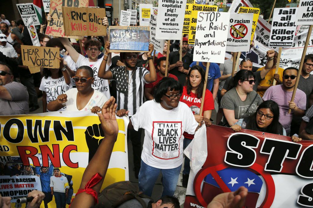 Donnie Pastard (center) of Cleveland protests with others as they march downtown in a fight against Trump before the start of the Republican National Convention in Cleveland, Ohio on Sunday, July 17, 2016. (Vernon Bryant/The Dallas Morning News)