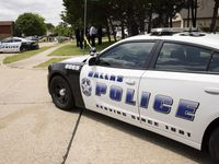 Dallas Police and members of the FBI investigate the scene where a toddler was found dead Saturday morning with multiple wounds on Saturday, May 15, 2021, in the Mountain Creek area of Dallas.