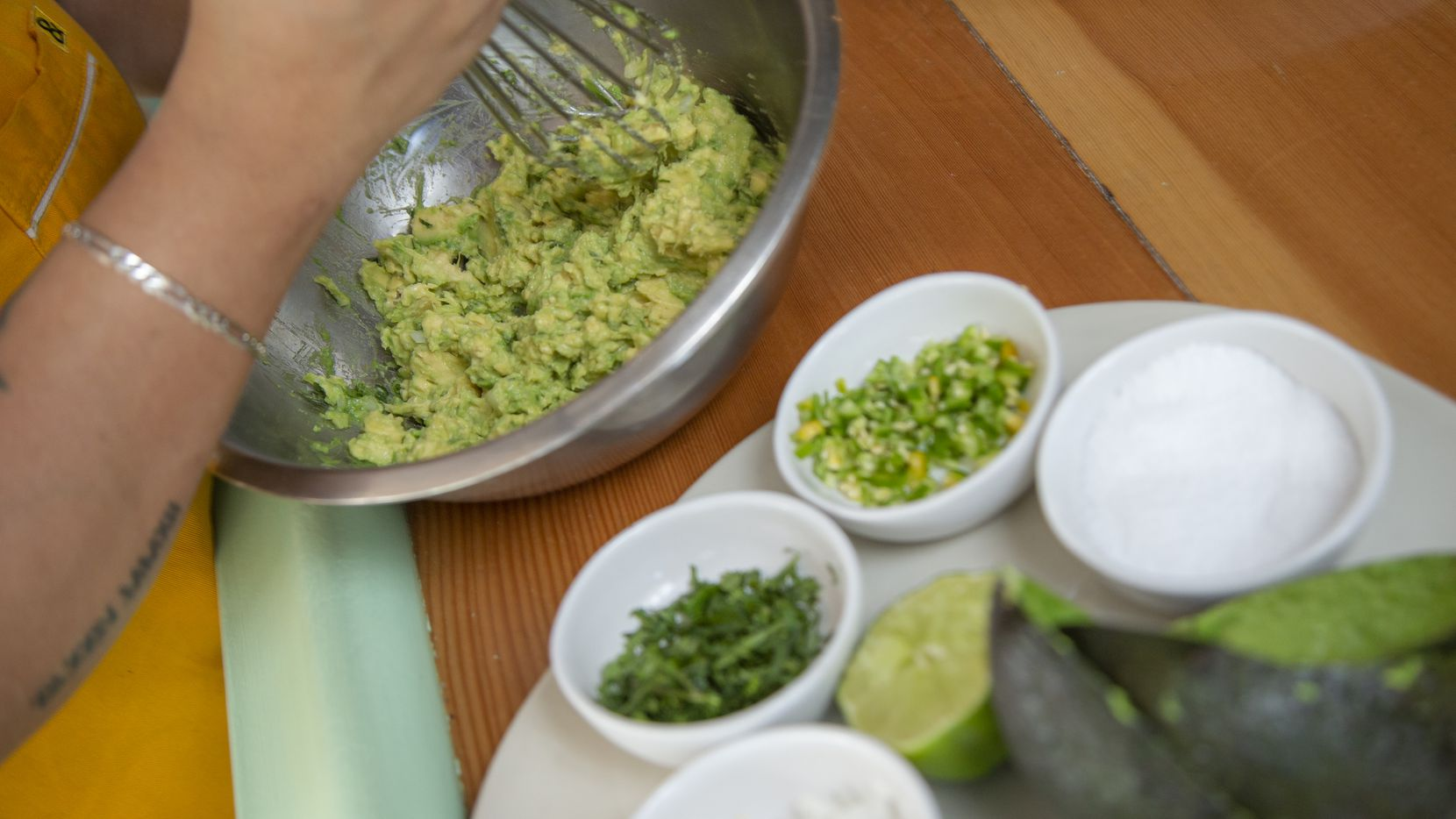 Chef Anastacia Quinones-Pittman prepares guacamole with onions, salt, lime juice, cilantro, and serrano peppers at Restaurant Jose, Wednesday, December 23, 2020.