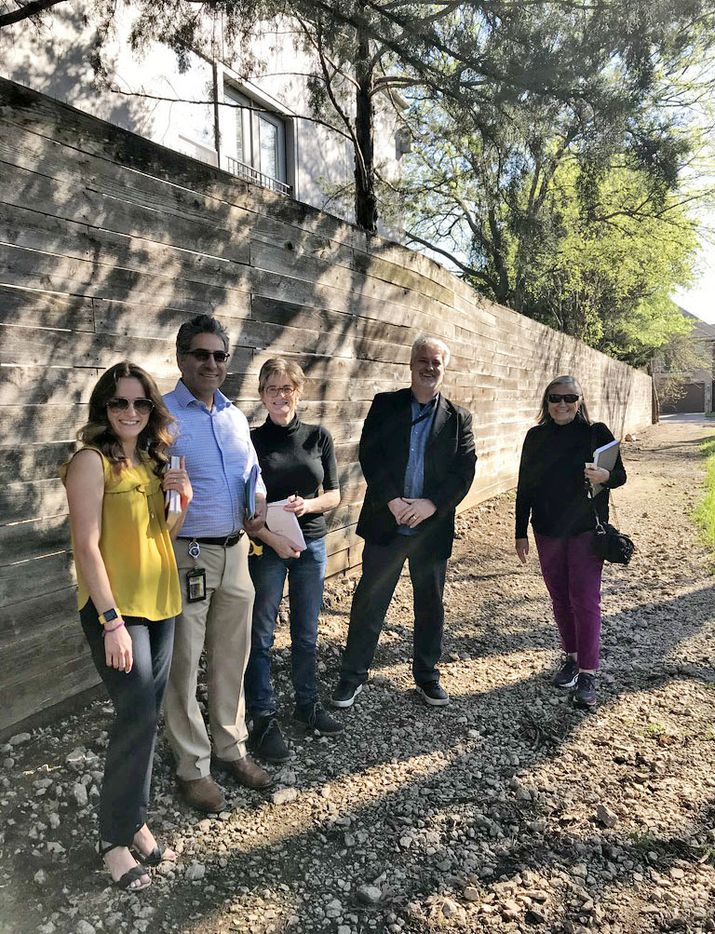 In March 2019, representatives of the City of Dallas met with neighborhood residents to discuss the proposed plan. From left are city planner Megan O'Neal and Neighborhood Vitality Grant administrator Kevin Acosta, resident Doris Clark, city planner Don Raines, and neighborhood project leader Judy Sullivan, who met along with neighborhood association president Meg Moschetto (not pictured). While no longer funded, the city neighborhood grant program supported at least 20 projects throughout all areas of Dallas, to improve signage, beautification, neighborhood engagement, litter abatement, and park or trail improvements.