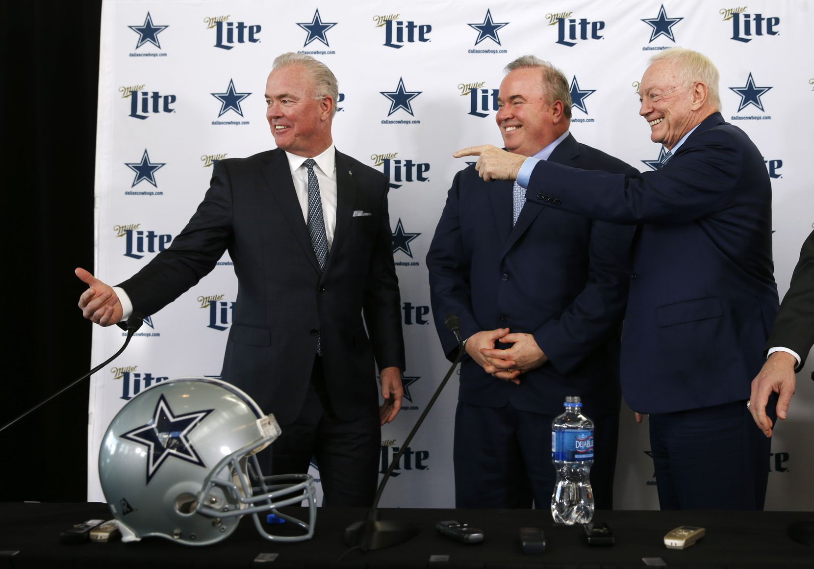 Dallas Cowboys executive vice president Stephen Jones, newly hired Dallas Cowboys head coach Mike McCarthy and Dallas Cowboys owner and general manager Jerry Jones talk after a press conference in the Ford Center at The Star in Frisco, on Wednesday, January 8, 2020.