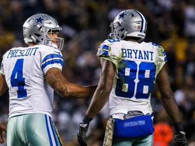 Dallas Cowboys quarterback Dak Prescott (4) talks to wide receiver Dez Bryant (88) after a touchdown during the fourth quarter of their game on Sunday, November 13, 2016 at Heinz Field in Pittsburgh, Pennsylvania.  (Ashley Landis/The Dallas Morning News)