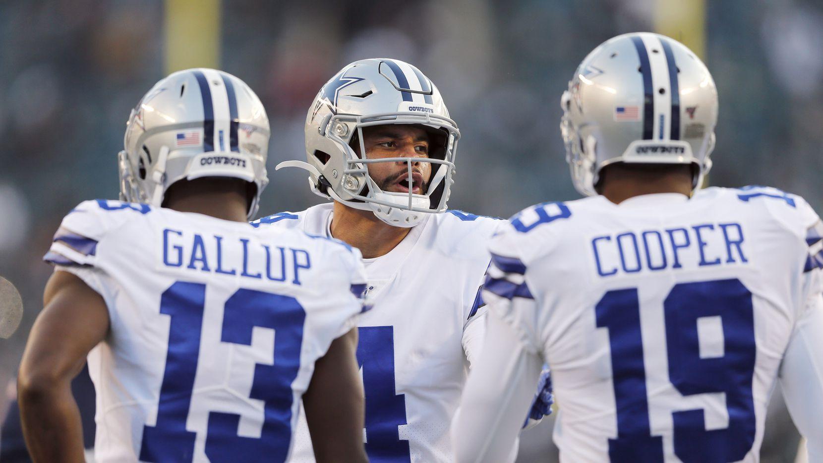 Dallas Cowboys quarterback Dak Prescott (4) talks with Dallas Cowboys wide receiver Michael Gallup (13) and Dallas Cowboys wide receiver Amari Cooper (19) during warmups before a game against the Philadelphia Eagles at Lincoln Financial Field in Philadelphia on Sunday, December 22, 2019.