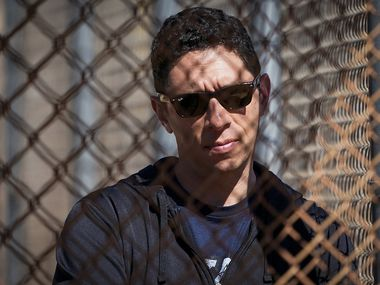 Texas Rangers general manager Jon Daniels watches during a spring training workout at the team's training facility on Thursday, Feb. 20, 2020, in Surprise, Ariz.
