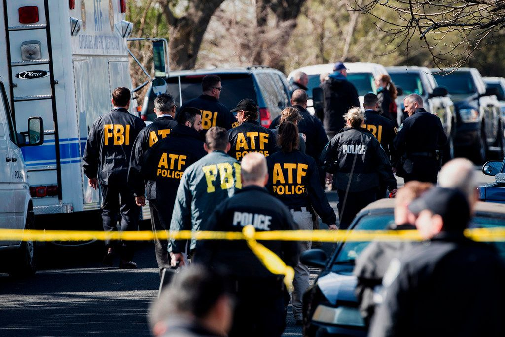 Authorities work at the scene of an explosion in Austin. A series of package bombs killed two people and seriously wounded four in March before suspect Mark Conditt blew himself up as police closed in.