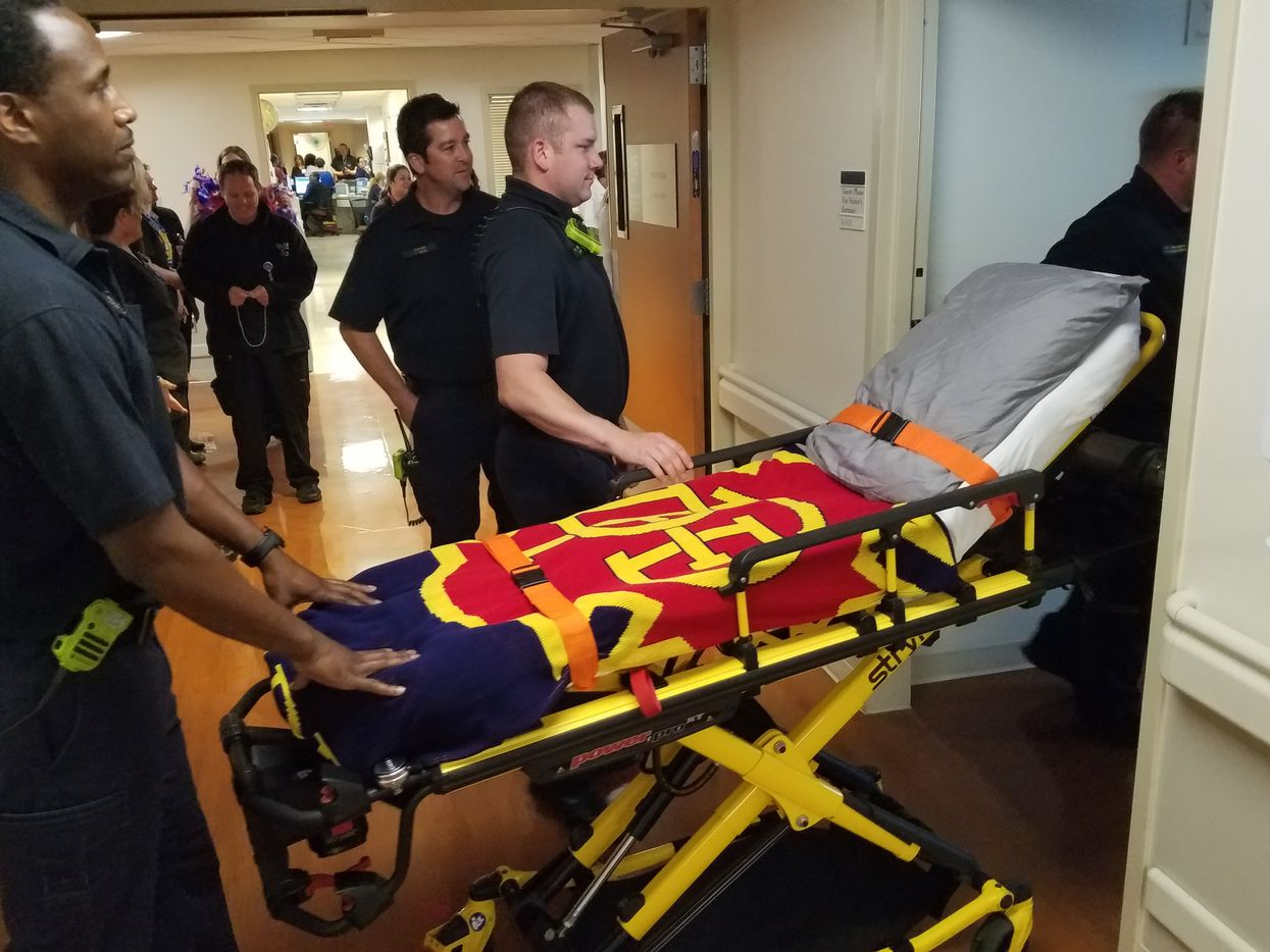 William An left the hospital in a stretcher resembling his hospital bed, complete with a Dallas Fire-Rescue blanket.