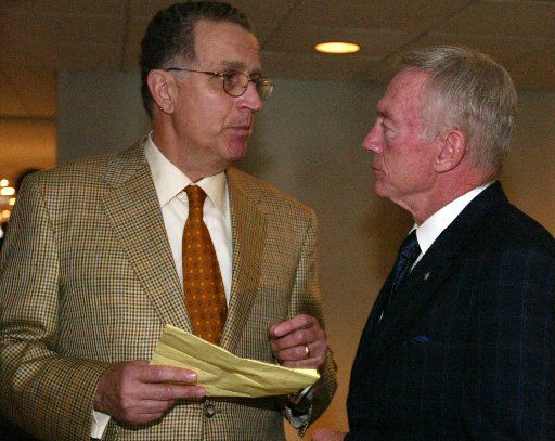 NFL commissioner Paul Tagliabue (L) and Dallas Cowboys owner Jerry Jones talk before the game between the Pittsburgh Steelers and the Dallas Cowboys at Texas Stadium in Irving on Sept 17, 2004.