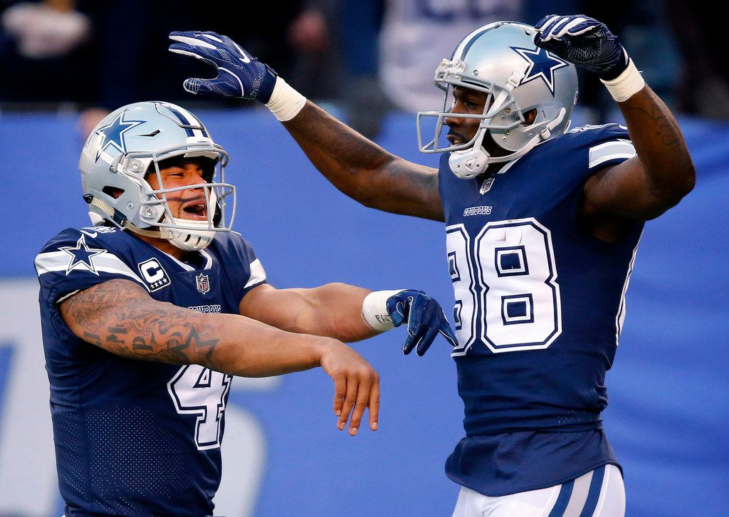 Dallas Cowboys quarterback Dak Prescott (4) and wide receiver Dez Bryant (88) celebrate running back Rod Smith's (45) fourth quarter touchdown catch and run against the New York Giants at MetLife Stadium in East Rutherford, New Jersey, Sunday, December 10, 2017. (Tom Fox/The Dallas Morning News)