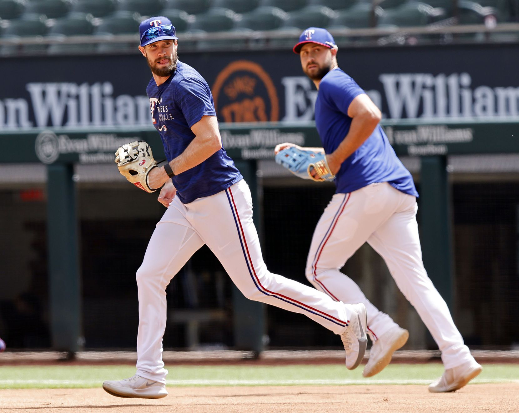 Texas Rangers David Dahl (left) and Joey Gallo take the field for batting practice before facing the Toronto Blue Jays on Opening Day at Globe Life Field in Arlington, Monday, April 5, 2021. The Rangers are facing the Toronto Blue Jays in the home opener. (Tom Fox/The Dallas Morning News)