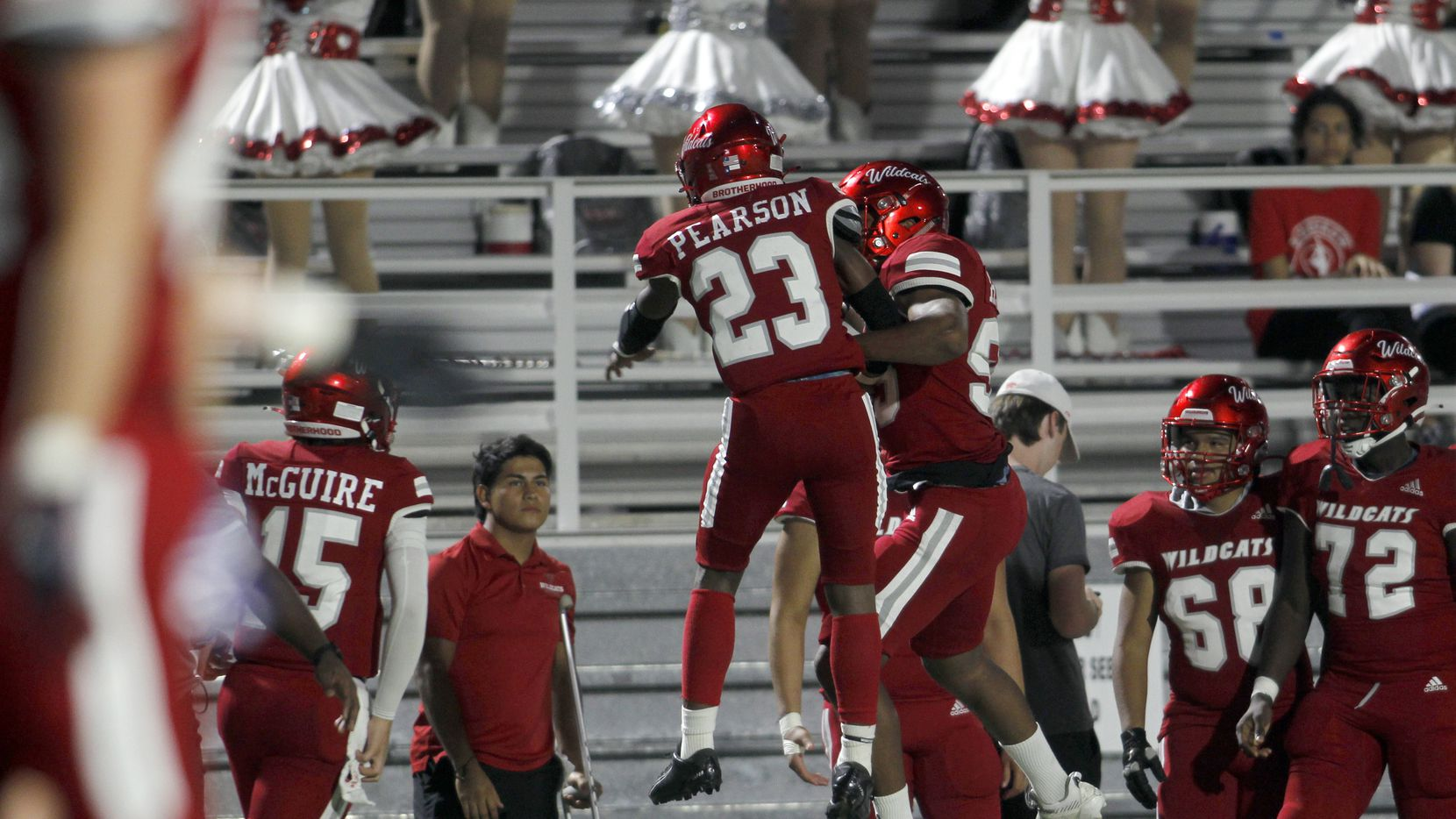 Woodrow Wilson running back Keitron Pearson (23) skies with a teammate in celebration of his first quarter rushing touchdown in their game against Bryan Adams. The two teams played their District 6-5A Division 1 football game at Forester Field in Dallas on October 14, 2021.