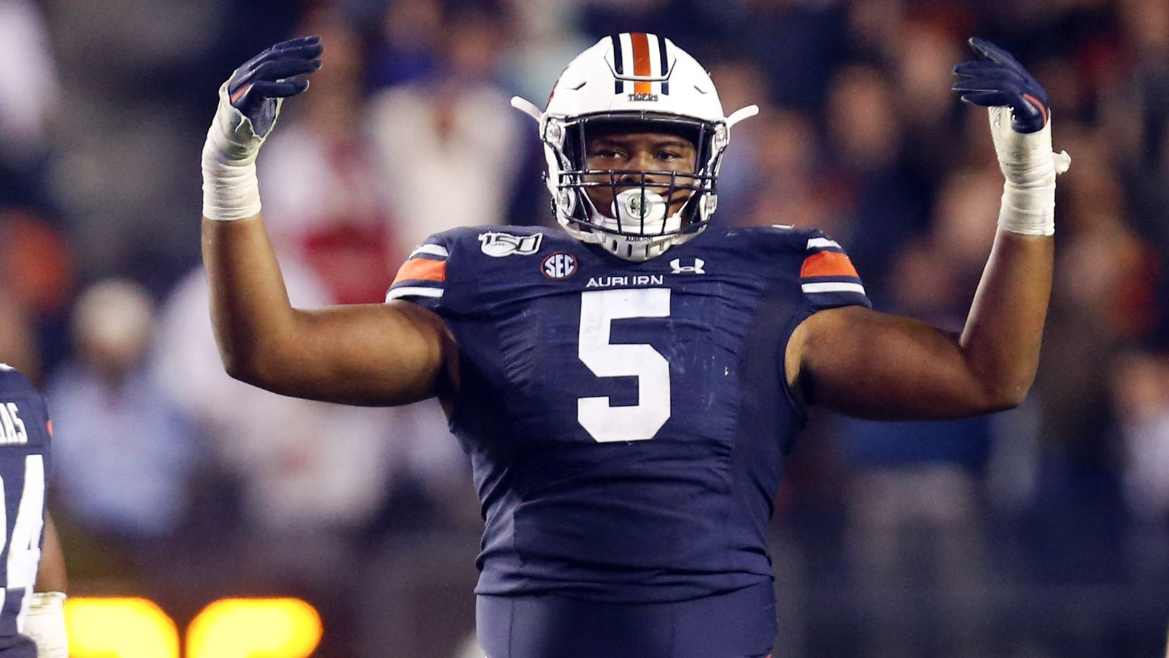 Auburn defensive tackle Derrick Brown (5) reacts after a stop against Georgia during the second half of an NCAA college football game, Saturday, Nov. 16, 2019, in Auburn, Ala. (AP Photo/Butch Dill)