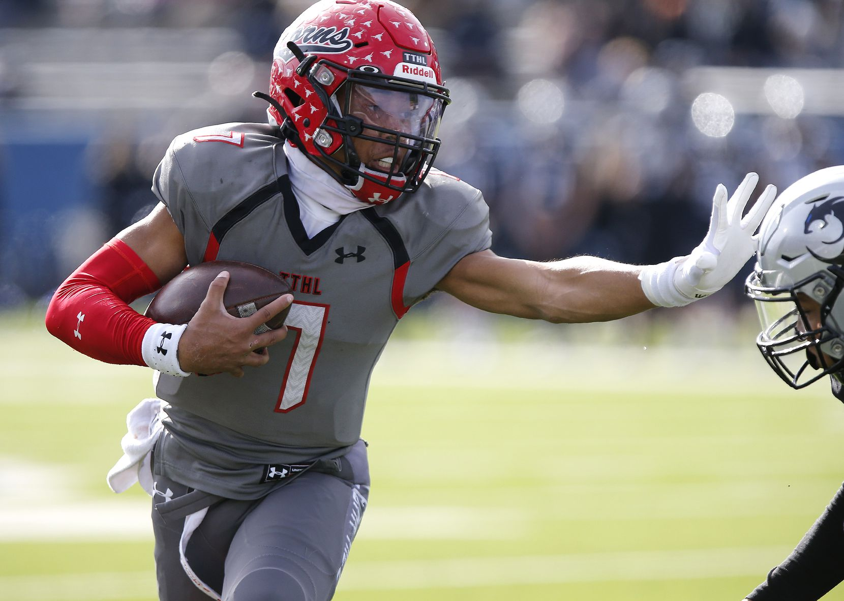 Cedar Hill quarterback Kaidon Salter (7) uses a stiff arm on a run during the first half of a game against Denton Guyer in a Class 6A Div. II state semifinal at McKinney ISD Stadium in McKinney on Saturday, Jan. 9, 2021.