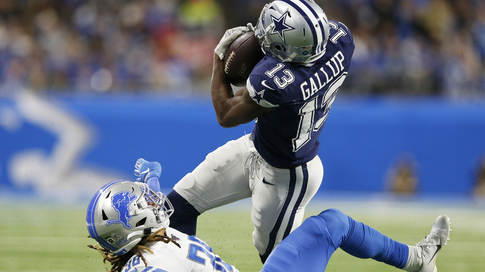 Dallas Cowboys wide receiver Michael Gallup (13) catches a ball hit by Detroit Lions defensive back Mike Ford (38) during the first half of play at Ford Field in Detroit, on Sunday, November 17, 2019. (Vernon Bryant/The Dallas Morning News)