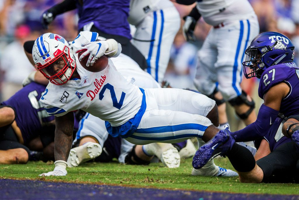 Southern Methodist Mustangs running back Ke'Mon Freeman (2) dives across the goal line for a touchdown during the second quarter of a college football game between SMU and TCU on Saturday, September 21, 2019 at Amon G. Carter Stadium in Fort Worth.