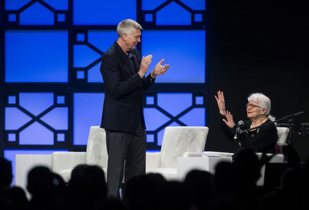 Southwest Airlines President Emeritus Colleen Barrett, right, attempts to calm an applauding crowd as Ron Ricks, vice chairman introduces her.