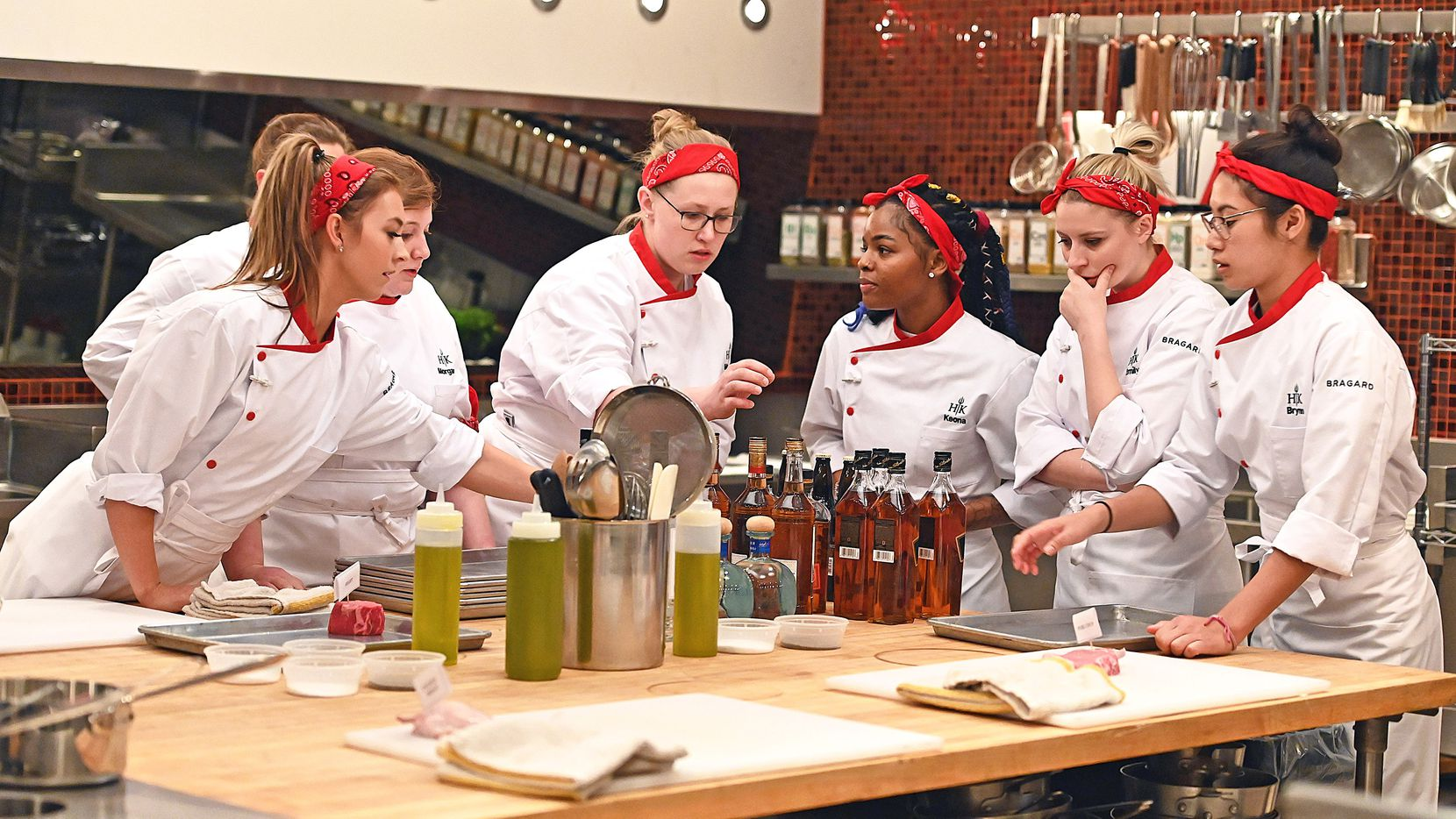 Denton chef Megan Gill, center, is the only Dallas-Fort Worth chef on 'Hell's Kitchen: Young Guns,' which premieres May 31, 2021 on Fox. To prepare for the show, Gill says she practiced cooking steak and seafood.