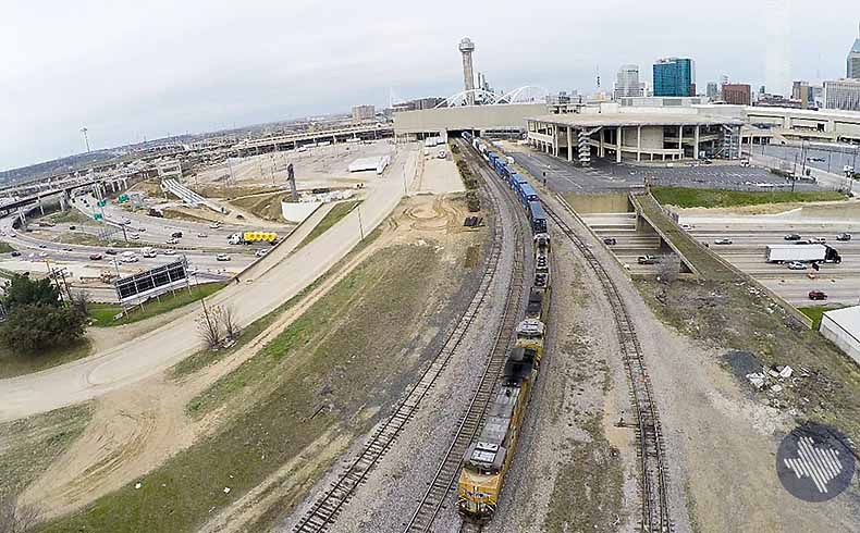 The prospective downtown Dallas terminal sites for Texas Central Railway's high-speed Dallas-to-Houston line lie along tracks that run through the South Side district and into the southern edge of downtown. This photo shows the area where both prospective sites are located.