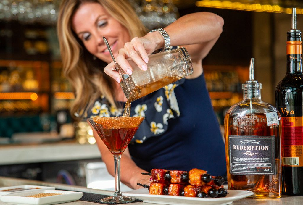 Perry's Hog-Hattan is a spicy Manhattan topped with pork chop bites and Luxardo cherries. This drink, available in Grapevine, Uptown Dallas and Frisco, is the latest in our Stir Crazy series.