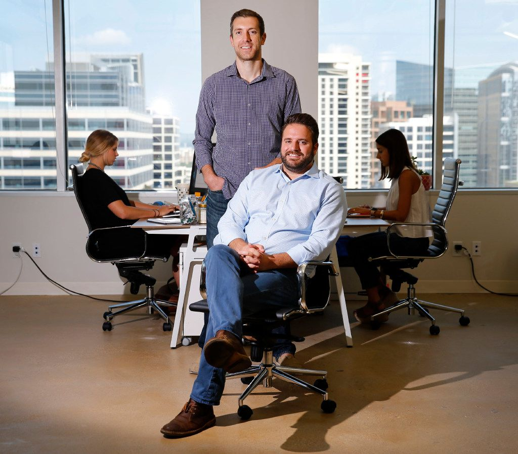 Modern Message co-founders John Hinckley (seated) and Michael Ivey expanded their offices in downtown Dallas. The startup, which was founded in 2012, created a loyalty and rewards platform that encourages apartment residents to promote their buildings. It recently raised $2 million in funding to expand.(Tom Fox/Staff Photographer)