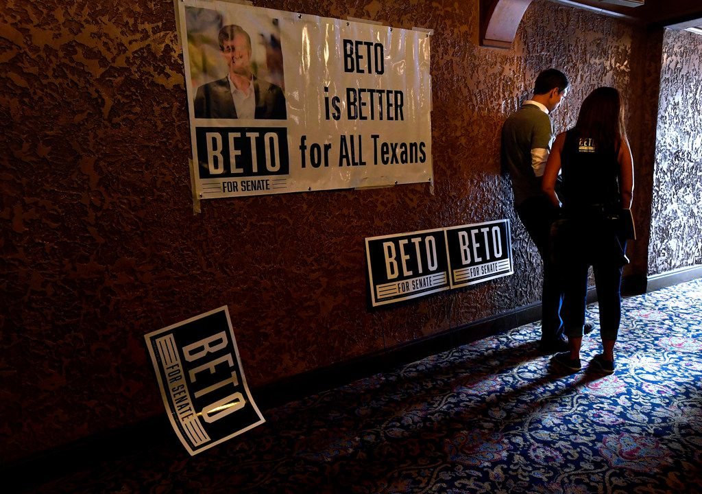 U.S. Senate candidate Beto O'Rourke read a message on his phone with a member of his campaign staff after completing the photo line at a town hall meeting at the Paramount Theatre on Aug. 2 in Abilene.. Five Democratic candidates spoke to a crowd of nearly 800 people in this community known traditionally as a Republican stronghold.