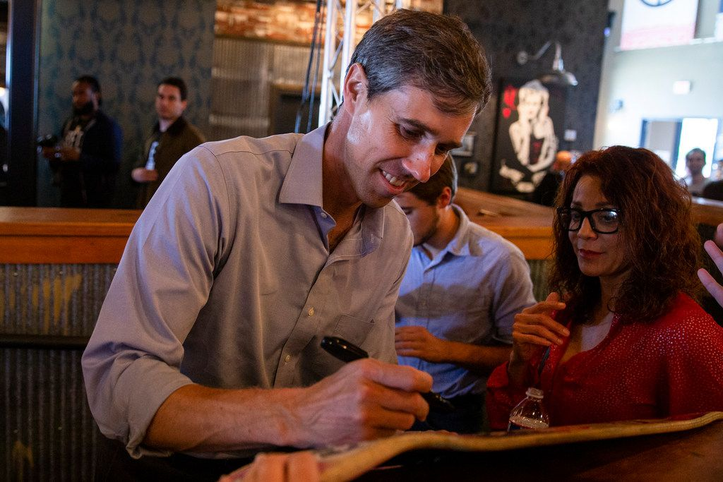 Congressman Beto O'Rourke signs a skateboard following a campaign rally  at Lava Cantina in The Colony, Texas on Saturday, October 20, 2018.