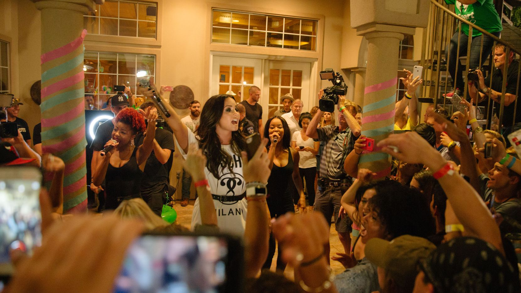 """Singer and actress Demi Lovato returned home to the Dallas area and performed at a Southlake fan's house as part of Lovato's House Party Tour. Lovato recently released a new single, """"Sorry Not Sorry."""""""