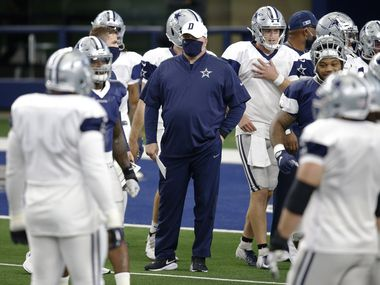 Dallas Cowboys head coach Mike McCarthy watches as players prepare to stretch for practice on Cowboys Night during training camp at AT&T Stadium in Arlington, Texas on Sunday, August 30, 2020.