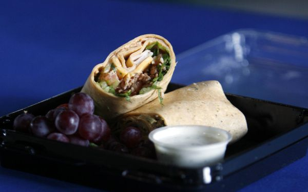 NOT THAT: The turkey BLT wrap sounds healthy and is even sold at the ballpark's healthy choice concession stand. But the wrap has many calories hidden in the cheese, bacon and dressing.