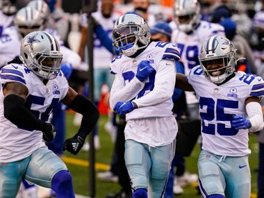 Dallas Cowboys cornerback Rashard Robinson, center celebrates a defensive stop against the Cincinnati Bengals with free safety Xavier Woods (25) and middle linebacker Jaylon Smith (54) in the second half of an NFL football game in Cincinnati, Sunday, Dec. 13, 2020.