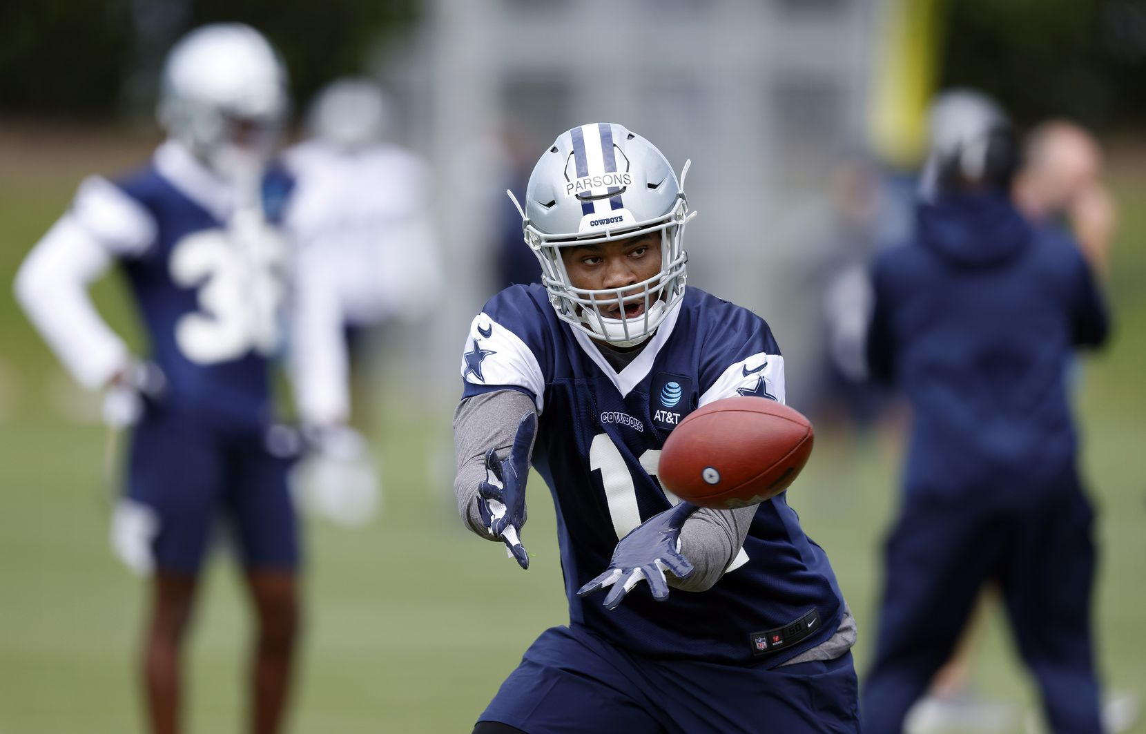 Dallas Cowboys rookie linebacker Micah Parsons (11) catches a pass during rookie minicamp at the The Star in Frisco, Texas, Friday, May 14, 2021. (Tom Fox/The Dallas Morning News)