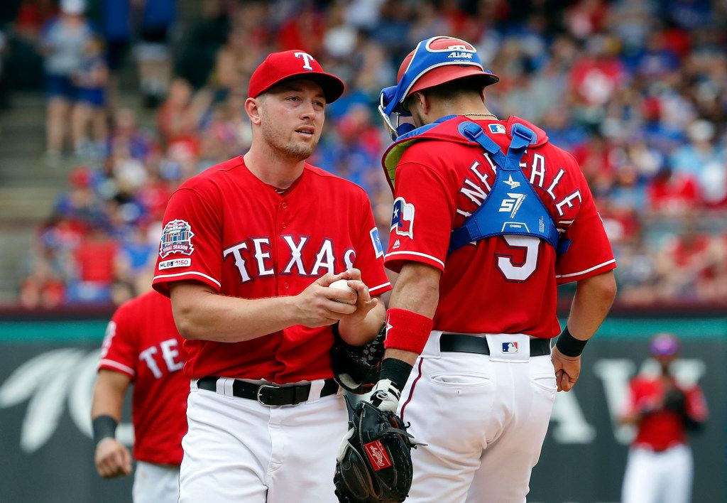 Texas Rangers starting pitcher Adrian Sampson visits with catcher Isiah Kiner-Falefa (9) after loading the bases in the fifth inning of a baseball game against the Kansas City Royals in Arlington, Texas, Sunday, June 2, 2019. (AP Photo/Tony Gutierrez)
