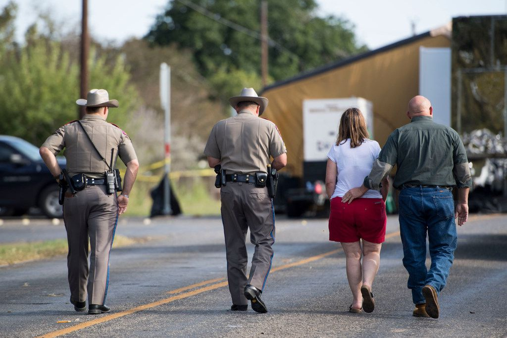 Texas state troopers walk with Sutherland Springs First Baptist Church Pastor Frank Pomeroy and his wife, Sherri Pomeroy, toward the church. MUST CREDIT: Washington Post photo by Carolyn Van Houten
