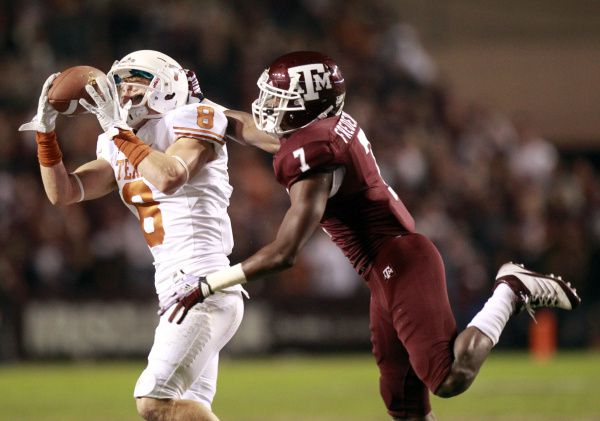 FILE - Texas wide receiver Jaxon Shipley (8) catches a pass over Texas A&M defensive back Terrence Frederick (7) during the first half of a game at Kyle Field in College Station on Thursday, Nov. 24, 2011. (Michael Ainsworth/The Dallas Morning News)