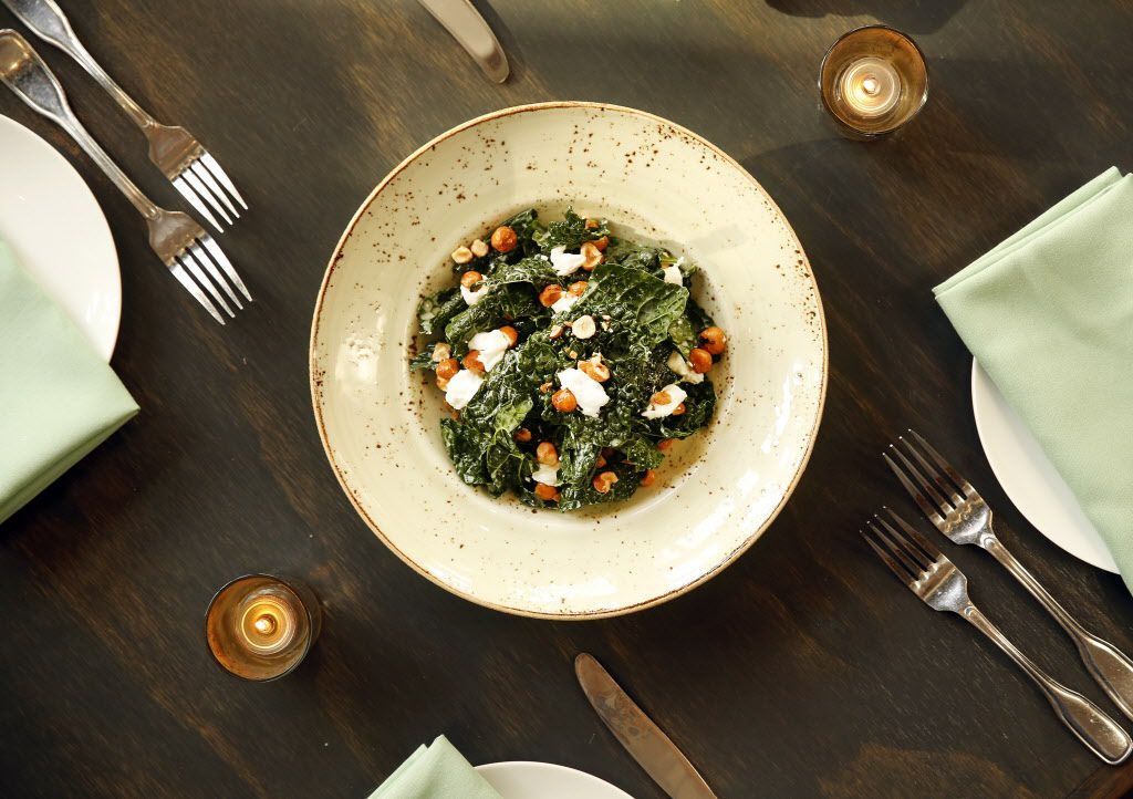 Remedy chef Danyele McPherson prepared lacinato kale salad with house-made ricotta and candied hazelnuts at their restaurant on Lower Greenville in Dallas, Tuesday, December 8, 2015.  (Tom Fox/The Dallas Morning News)