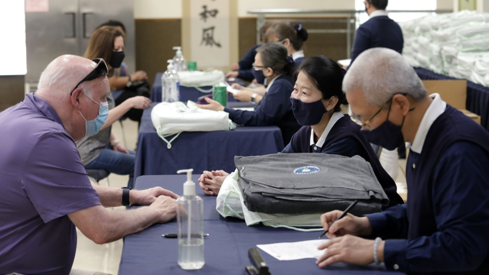 Families displaced in a recent Addison fire receive help at the Tzu Chi foundation in Richardson, TX, on Apr. 25, 2021. (Jason Janik/Special Contributor)