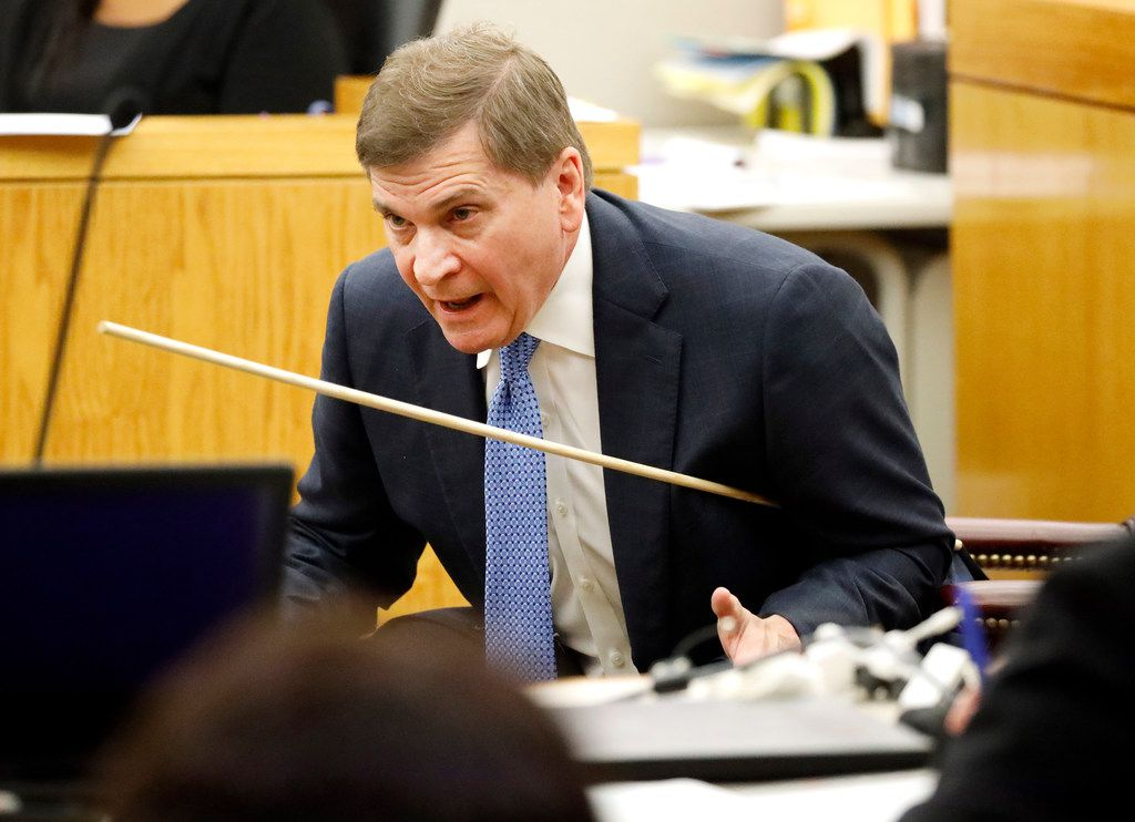 Defense attorney Toby Shook uses a rod to show where Botham Jean was shot during his closing arguments in the 204th District Court at the Frank Crowley Courts Building in Dallas, Monday, September 30, 2019.