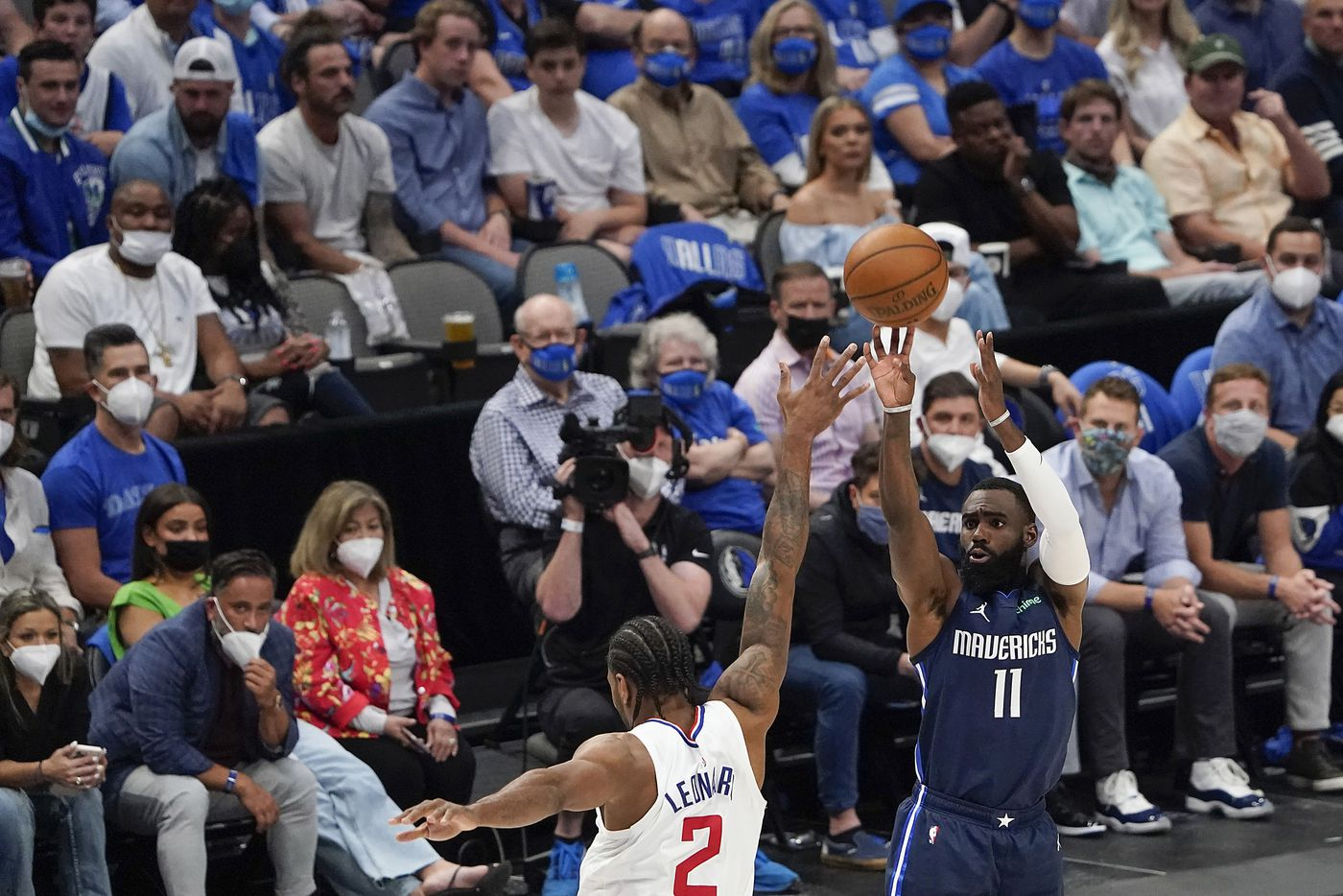 Dallas Mavericks forward Tim Hardaway Jr. (11) shoots over LA Clippers forward Kawhi Leonard (2) during the second quarter of an NBA playoff basketball game at American Airlines Center on Friday, May 28, 2021, in Dallas.