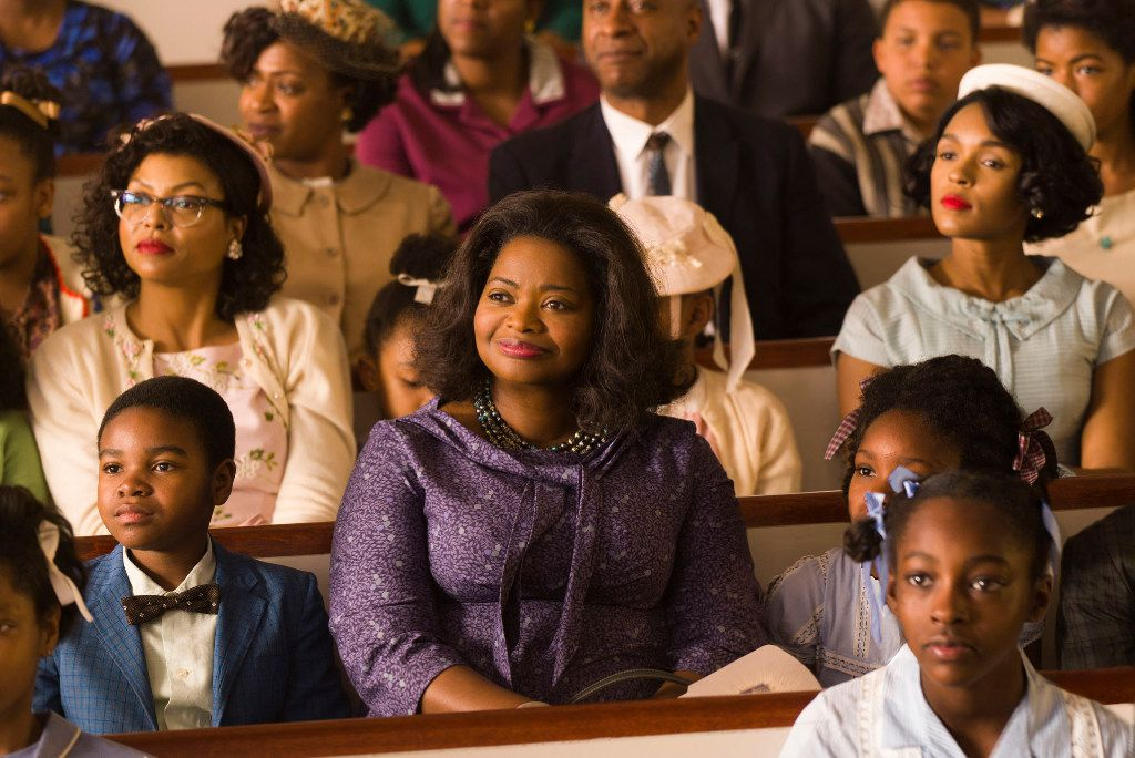 Taraji P. Henson, background left, Octavia Spencer, center, and Janelle Monae, background right, in a scene from Hidden Figures.