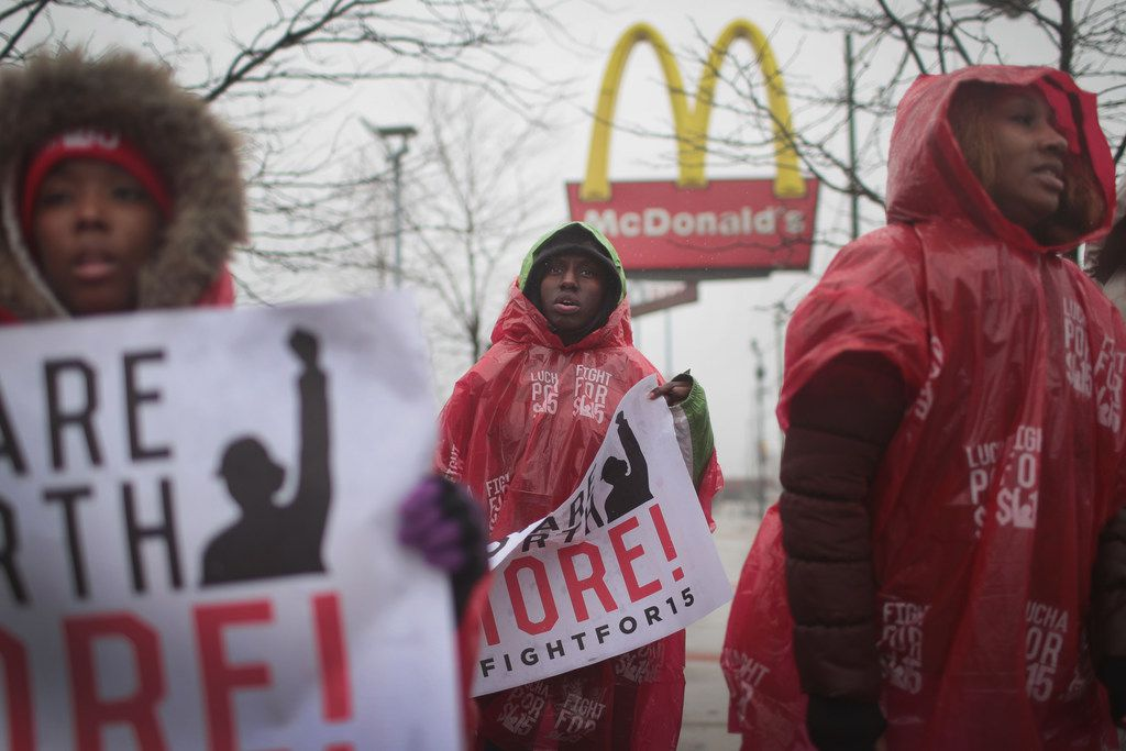 McDonald's workers and their supporters protest outside of a company-owned restaurant on April 3, 2018 in Chicago, Ill. The workers were protesting what they claim is a broken promise by the company to pay workers at its corporate-owned stores $1 per hour above the local minimum wage.