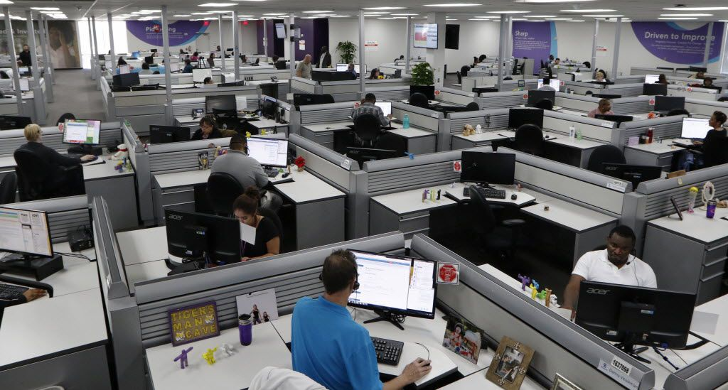 Teladoc customer service representatives work in its Lewisville office call center.