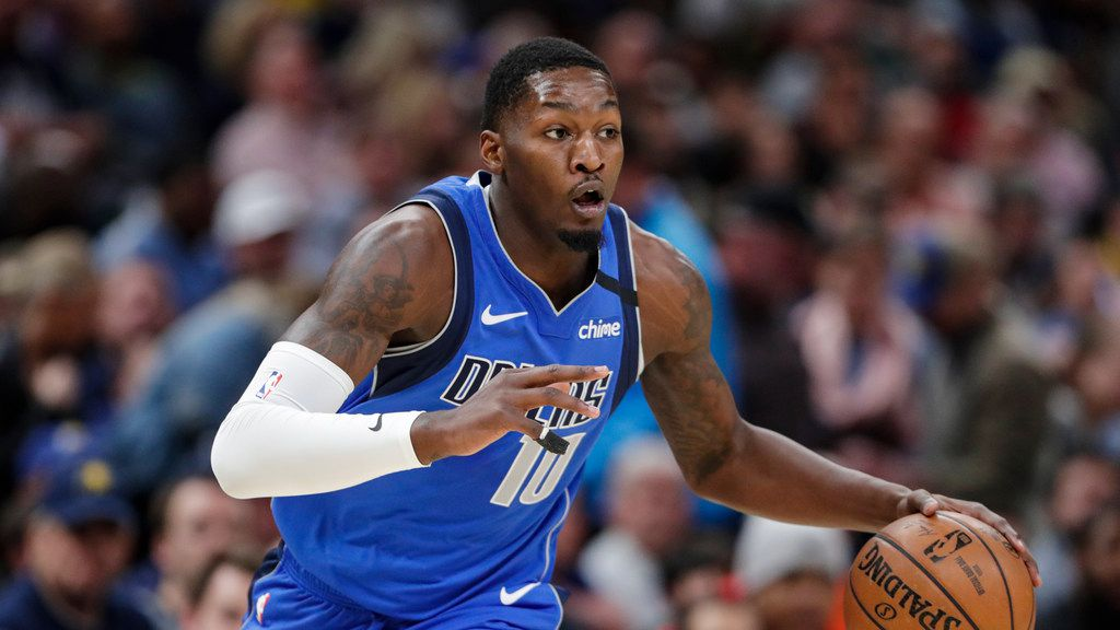 Dallas Mavericks forward Dorian Finney-Smith (10) plays against the Indiana Pacers during the first half of an NBA basketball game in Indianapolis, Monday, Feb. 3, 2020.