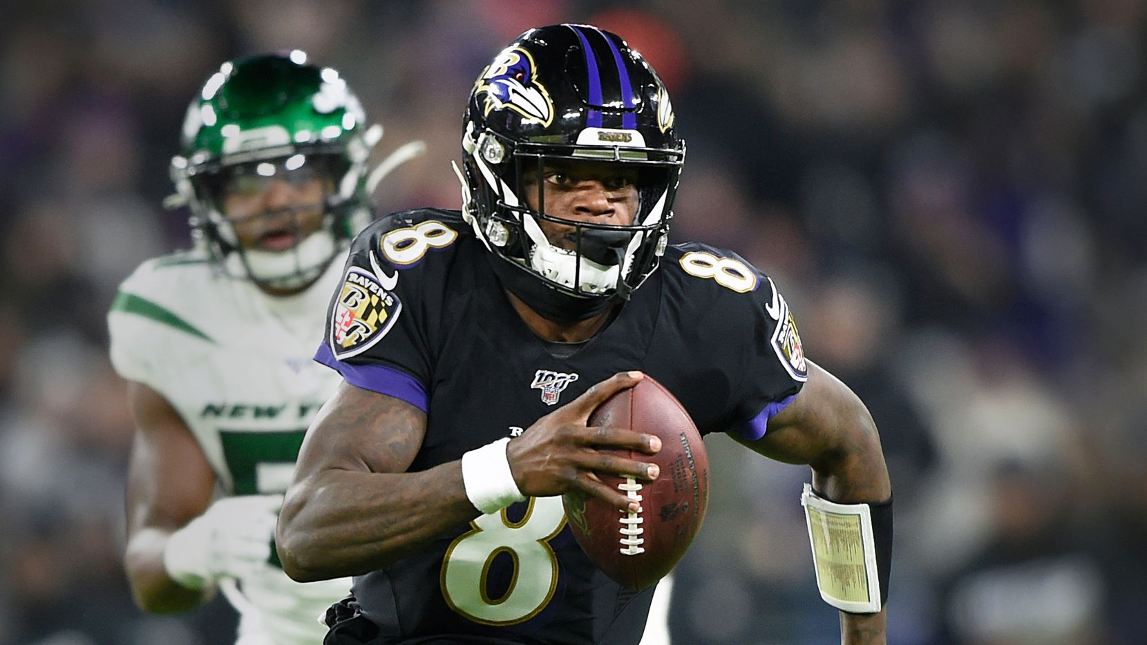 Dec. 12, 2019: Ravens quarterback Lamar Jackson (8) runs past New York Jets linebacker Brandon Copeland (51) during an NFL football game. (AP Photo/Gail Burton, File)